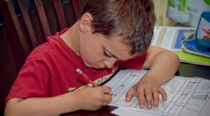preschooler completing a worksheet