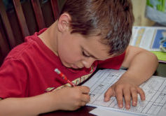 preschooler completing a worksheet